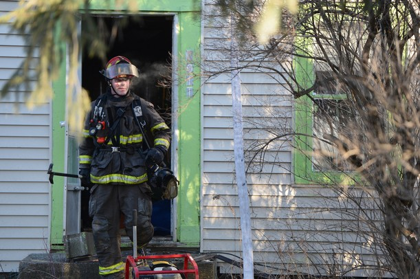 Firefighters from Ann Arbor Township, Superior Township and Salem Township work to put out a fire at 7011 Vreeland in Superior Township on Wednesday morning. Melanie Maxwell I AnnArbor.com